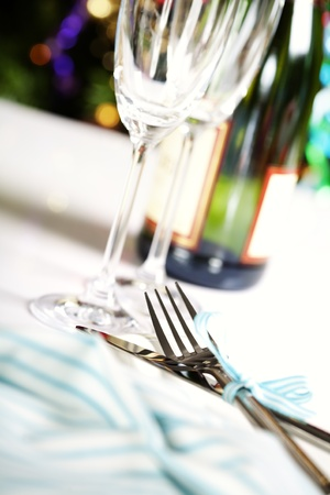 dinning table: place setting on Christmas tree background