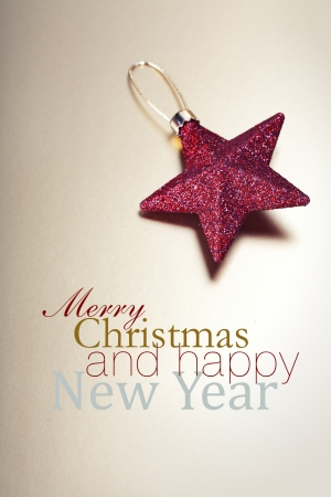 bedeck: Red Christmas star over gold Stock Photo