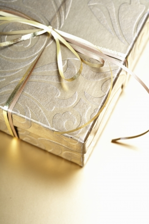 Golden gift box with golden ribbon photo
