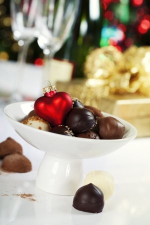 Delicious chocolate pralines and truffles with Christmass heart Stock Photo - 16124775