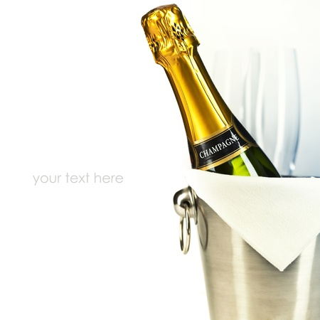 green glass bottle: Champagne bottle in cooler and two champagne glasses (with easy removable sample text)