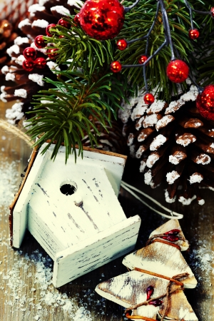 silver star: Bright christmas composition with small birdhouse