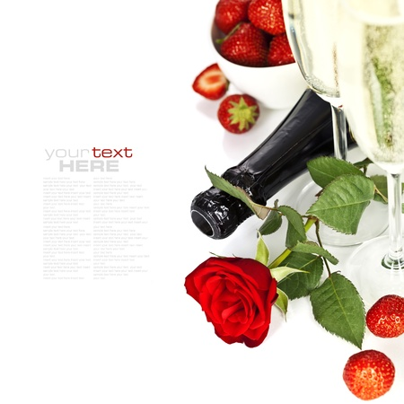 Romantic still life with champagne, strawberry and beautiful red roses over white (with easy removable text) photo