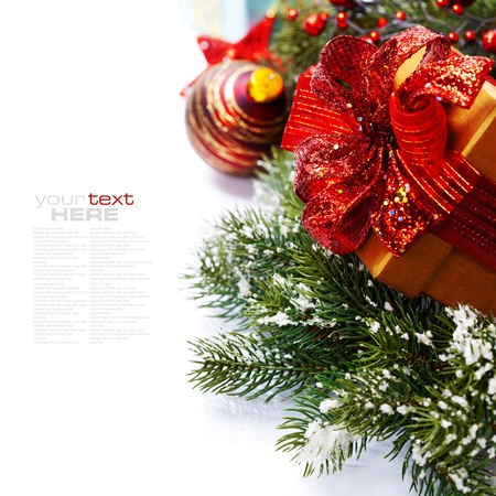 Christmas composition with gift box and decorations (with easy removable sample text) photo