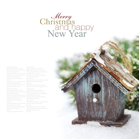 christmas baubles of modern design: Bright christmas composition with small birdhouse (with easy removable sample text) Stock Photo