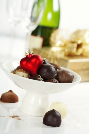 Delicious chocolate pralines and truffles with Christmass heart photo