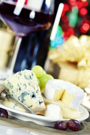 ricotta cheese: Cheese and wine on Christmass tree background