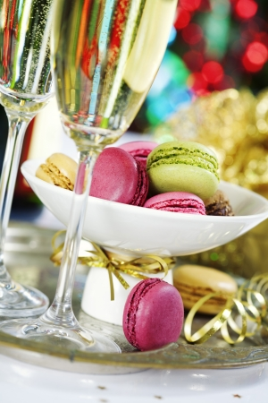 Colorful macaroons and Champagne on Christmass tree background Stock Photo - 16827015