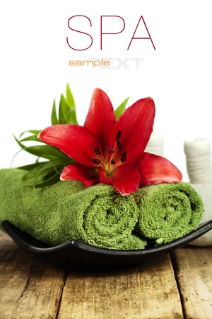 lilia: Fresh flowers, towels and Herbal massage balls on wooden surface (with easy removable sample text)