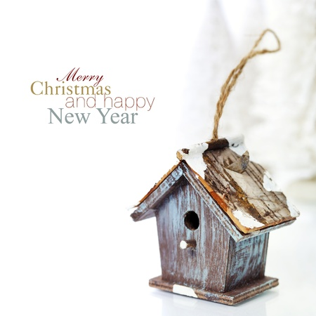 Bright christmas composition with small birdhouse (with easy removable sample text) photo