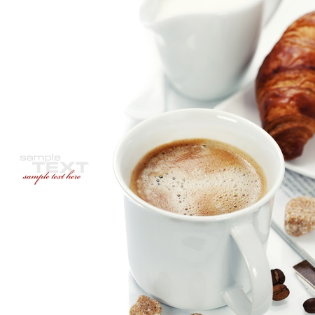 breakfast with coffee, croissant and magazine (with sample text) photo