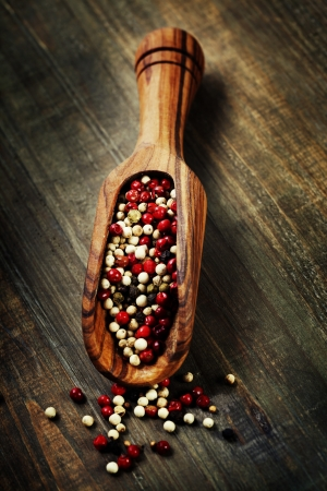 Peppercorn mix in wooden scoop photo