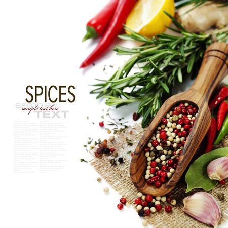 Peppercorn mix in wooden scoop, herbs and spices (with easy removable text) photo