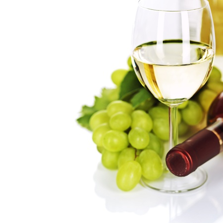 botle: A glass of white wine and grape over white