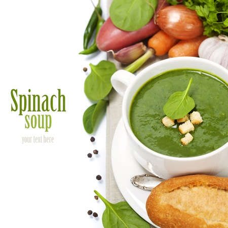 Traditional Spinach cream soup with croutons and fresh spinach leaf on top  with easy removable sample text  photo