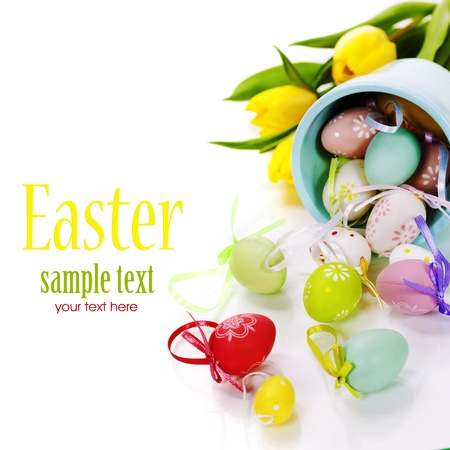easter decorations: easter composition with fresh tulips and easter eggs over white (with easy removable text)
