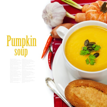 Traditional Pumpkin soup in white bowl  with ingredients (with easy removable sample text) photo