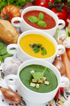 Three traditional soups (tomato, pumpkin and  spinach). Traffic light concept photo