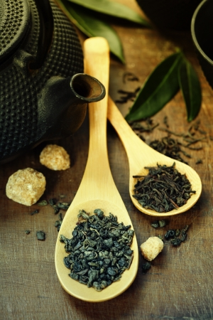Green and black tea on wooden table photo