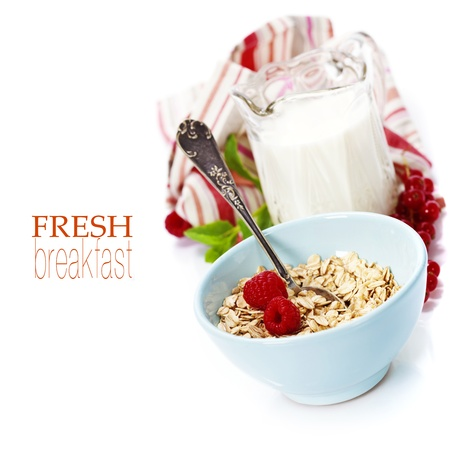 wooden insert: bowl of oat flake, berries and fresh milk on white background - health and diet concept (with easy removable sample text)