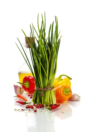 A bunch of fresh chives and vegetables over white photo