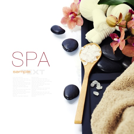 spa concept (zen stones, Herbal massage balls and towel) over white (with easy removable sample text) photo
