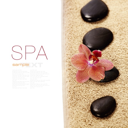 organic spa: spa concept (zen stones,  orchid flower and towel) over white  (with easy removable sample text)