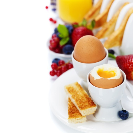 Delicious breakfast with eggs, fresh toasts, fructs and juice Stock Photo