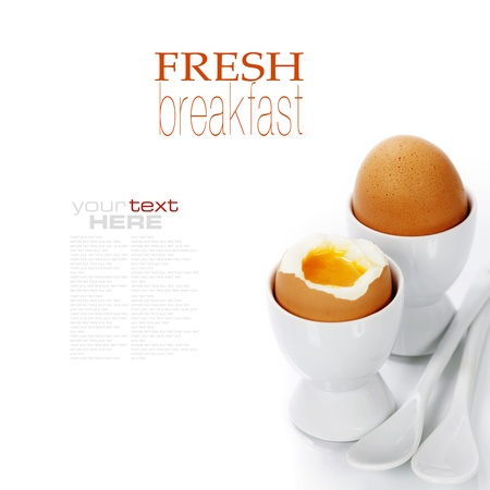 eggcup: Delicious breakfast with Boiled Eggs in Eggcups (with easy removable text) Stock Photo