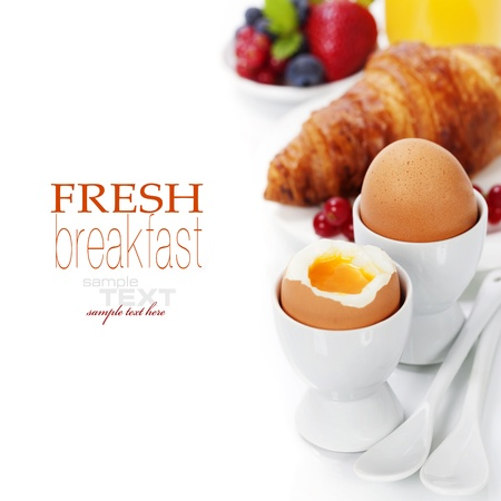 breakfast food: Delicious breakfast with eggs, fresh croissants, fructs and juice (with easy removable text)