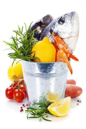 the dorada: fresh dorada fish with vegetables over white