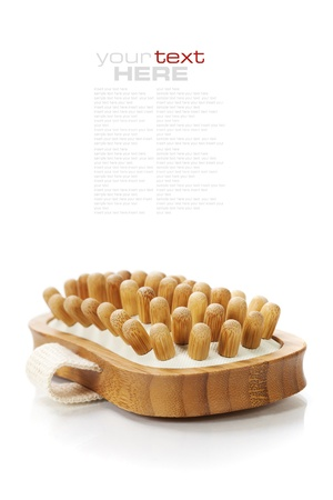 wooden insert: Spa and Wellness- anti-cellulitis spa massage brush isolated on white Stock Photo