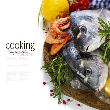 dorado fish: fresh seafood and vegetables on ice