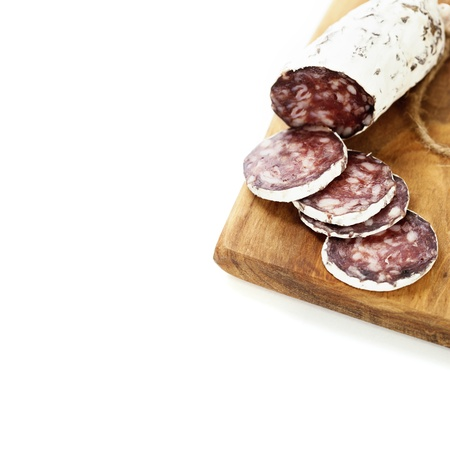 air dried salami: Close-up traditional sliced meat sausage salami on wooden board