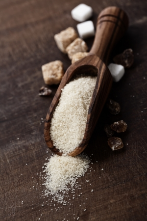 sugar: Various kinds of sugar on wooden board Stock Photo
