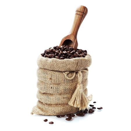 bean bag: Coffee beans in burlap sack with wooden scoop over white