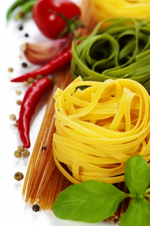 colord: whole wheat spaghetti and egg pasta nests over white Stock Photo