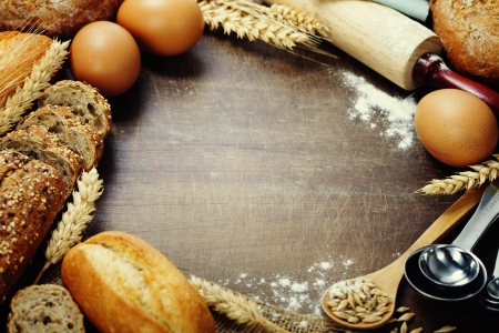 french bakery: Bread and ingredients frame on wooden table Stock Photo