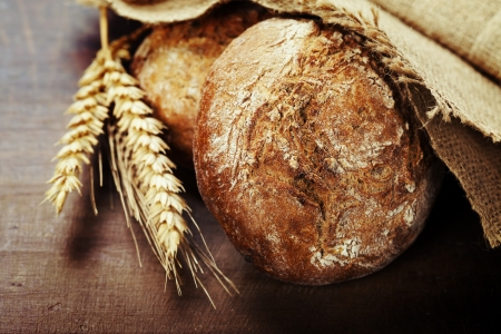 french bread: Freshly baked  bread on wooden table Stock Photo