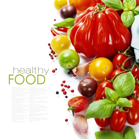 removable: Assorted colorful tomatoes and herbs on white background - healthy eating concept (with easy removable sample text)