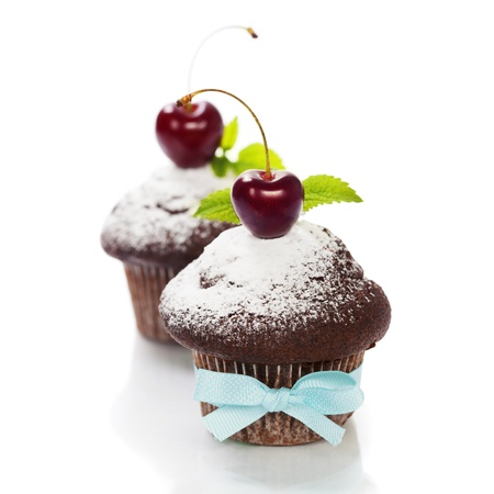 fresh chocolate muffins with cherry photo