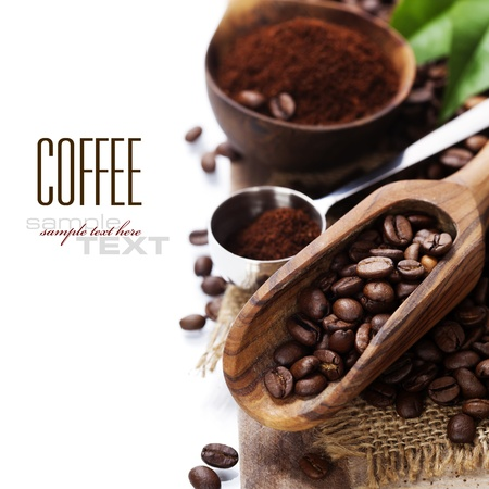 coffee grains: Coffee beans and an old wooden scoop (with sample text)