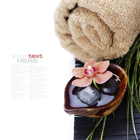 stone bowl: spa concept (zen stones, orchid flower and towel) over white (with easy removable sample text) Stock Photo