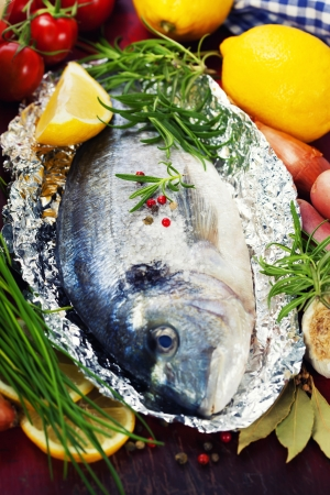 fresh dorada fish with vegetables photo
