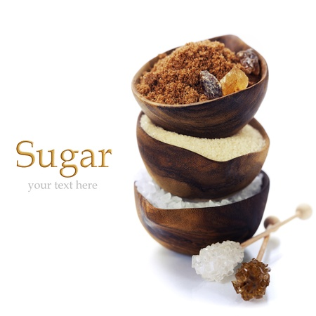 Various kinds of sugar in wooden bowls (with easy removable sample text)