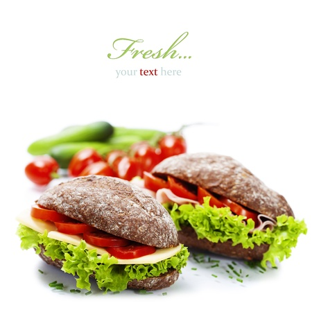 breakfast food: Grain bread sandwiches with ham,cheese and fresh vegetables over white - healthy eating concept (with easy removable sample text)