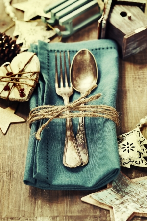 family dining: Christmas table place setting with christmas decorations