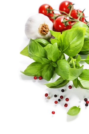 basil leaves and fresh vegetables on white background Stock Photo