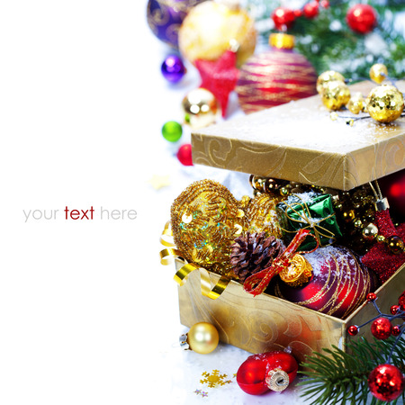christmas decorations in the box on the white background  (with easy removable sample text) photo
