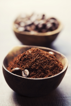 green bean: Wooden Bowls with coffee beans and ground coffee